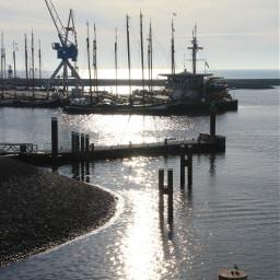 sunset backlight sea boats reflection
