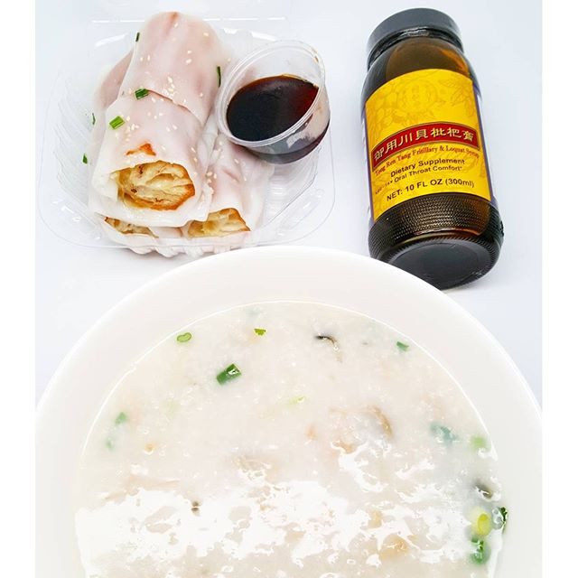 Salted pork & preserved egg porridge + Chinese donut wrapped with rice noodle + pei pa throat syrup... because my throat is killing me! 😭 What are your sore throat remedies? Comment below.