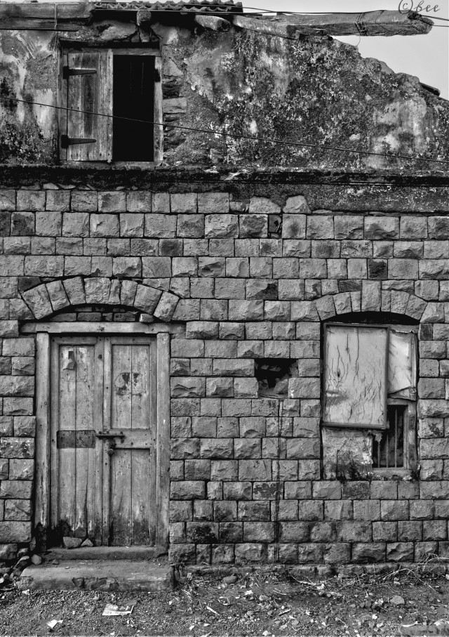 With small villages being replaced by highrises,standalone houses of these kind are fast vanishing in the hamlets that dot the coastline of Arabian sea..this small township was once a Portuguese colony in preindependent India   #blackandwhite  #monochrome   #monochromephotography  #streetphotography  #house  #brick  #door  #window  #abandonment  #solitary  #rural  #decay  #urbandecay  #blackandwhitephotography #india